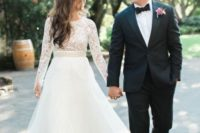 22 an elegant wedding look with a full layered skirt and a lace top with long sleeves and a high neckline