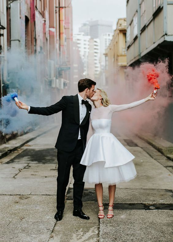 colorful smoke bombs are a fun and modern idea to stand out during your wedding exit