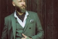a hipster look with a grey three-piece wedding suit, a white shirt and a polka dot cravat tie
