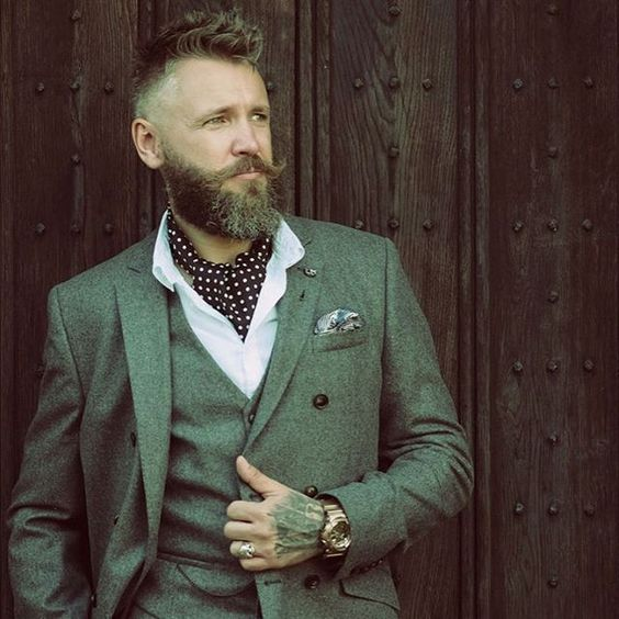 a hipster look with a grey three piece wedding suit, a white shirt and a polka dot cravat tie