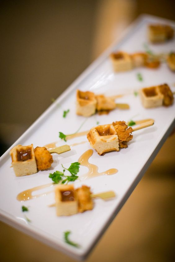 chicken and waffles bites with greenery are a cool bite idea for many weddings