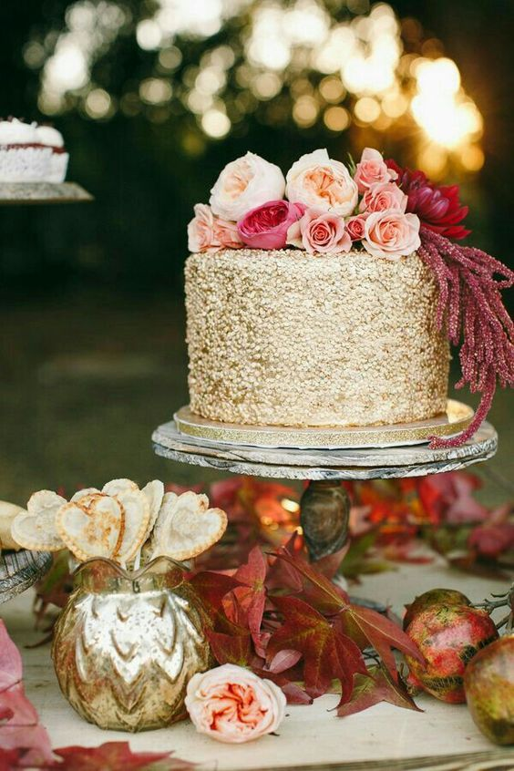 a fantastic fall wedding cake with gold sequins and fresh pink and blush blooms on top