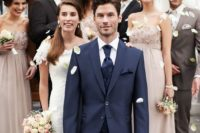 24 a gormal navy suit with a white shirt and a printed cravat tie for an elegant feel