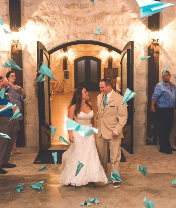 paper planes are a whimsy and fun idea and will add a dreamy touch to your wedding exit