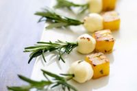 24 rosemary pineapple mozzarella bites are perfect one bite appetizers and many guests willlove this combo