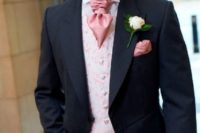 25 a chic black morning suit, a pink printed waistcoat and a pink cravat tie for a formal look