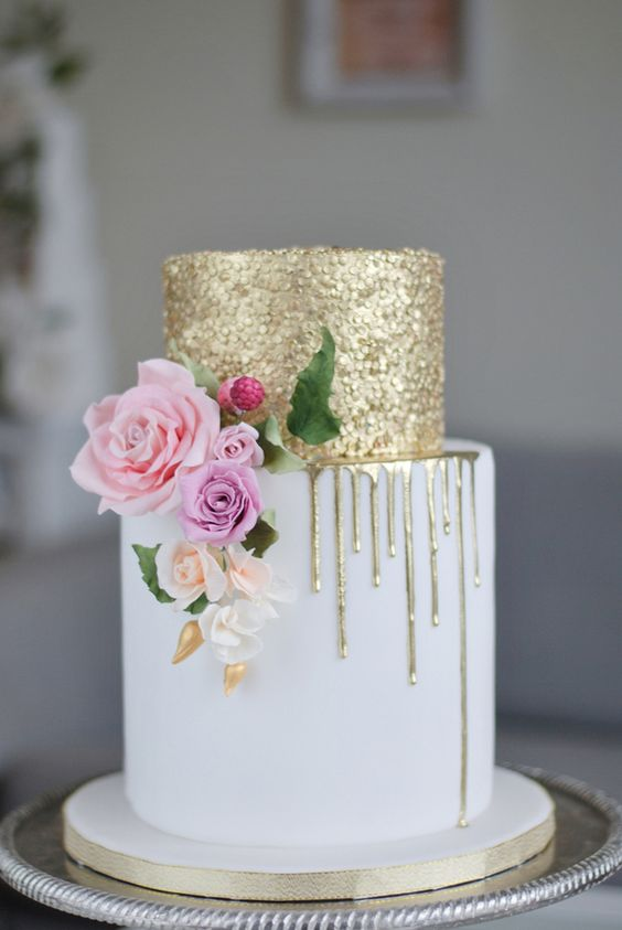 a show-stopping wedding cake with gold sequins and dripping plus natural blooms for decor