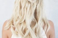 25 a simple twisted half up braid with textural waves down is a good idea to look effortlessly chic and relaxed