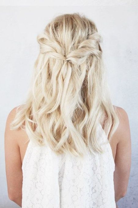 a simple twisted half up braid with textural waves down is a good idea to look effortlessly chic and relaxed