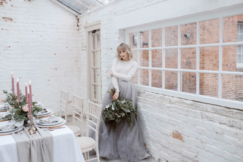 a white plain long sleeve top and a layered grey tulle skirt for a modenr bride