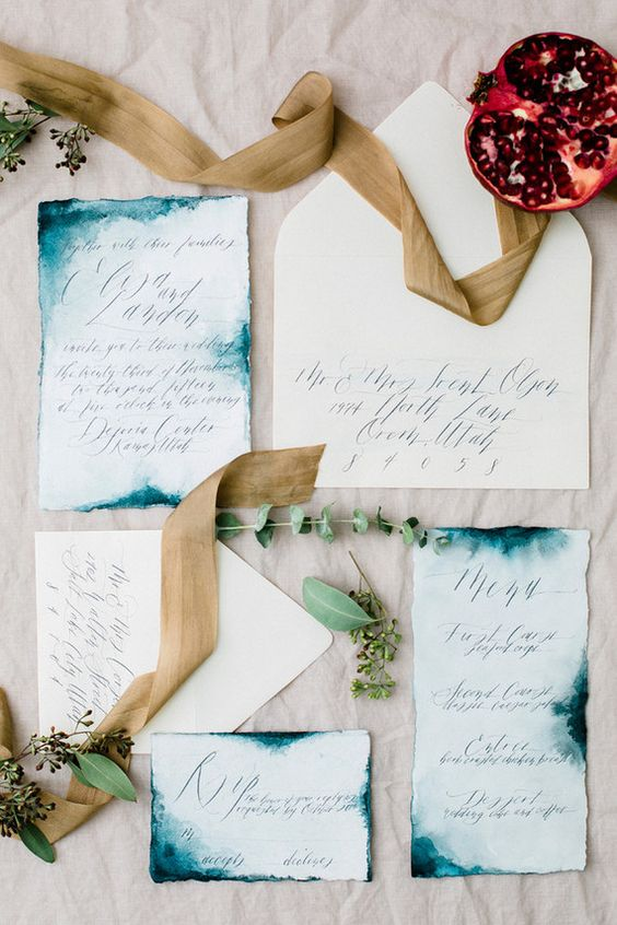 chic indigo watercolor edge invitation suite with a deckle edge and calligraphy for a bold wedding