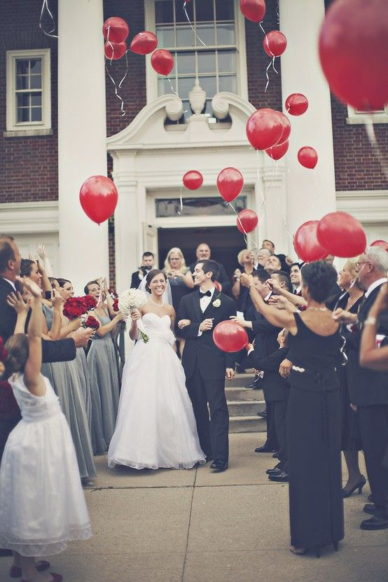 red balloons are a bright and catchy alternative to usual rice, especially if it's a Valentine's Day wedding