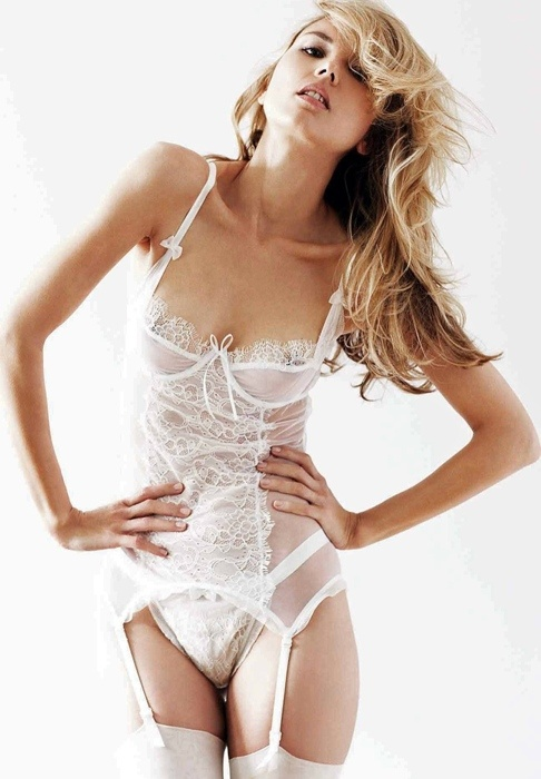 a white sheer corset with lace, matching panties and stockings for a wow look