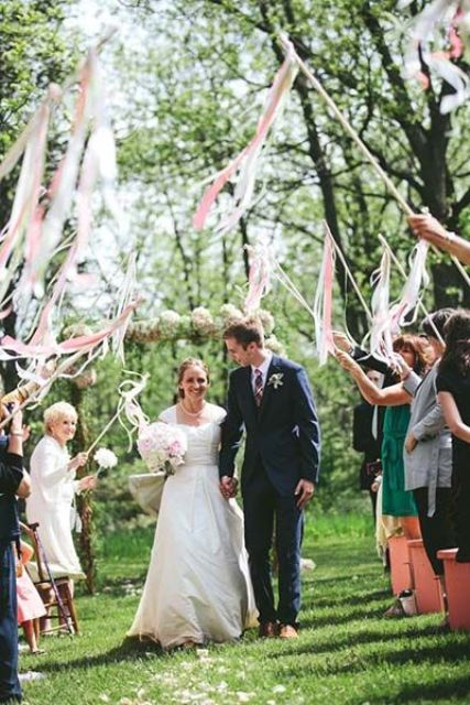 ribbon wand send off is another cool and fun idea for your wedding exit and they won't land on your dress