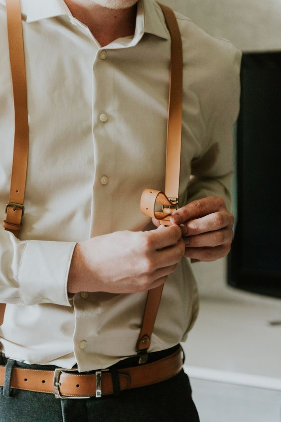 rock leather suspenders and a belt in the same color for a vintage-inspired groom's look