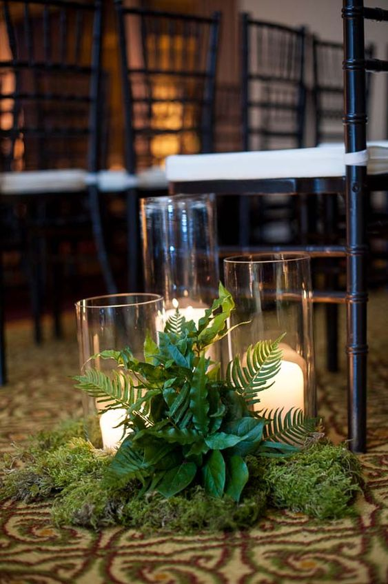 wedding aisle decor with moss, ferns, foliage and candles - you won't need more for a cute and natural look