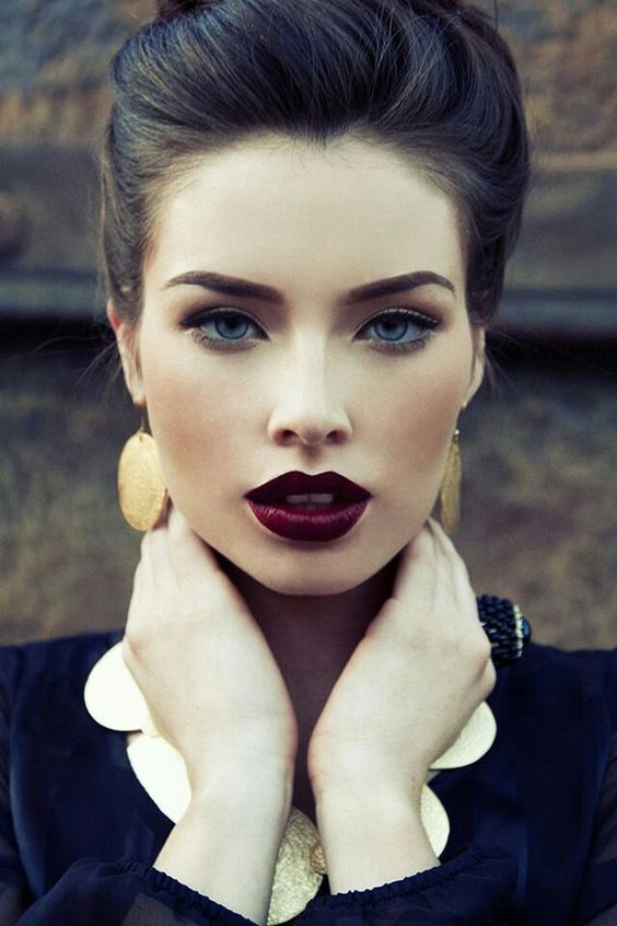 a very dark and plump berry lip is a bright statement for a light makeup, don't make any other accents