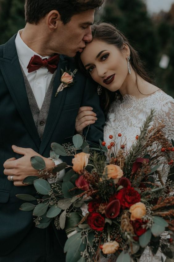 a very dark burgundy bridal lip is exactly what you need to make your winter wedding look a bit decadent and refined