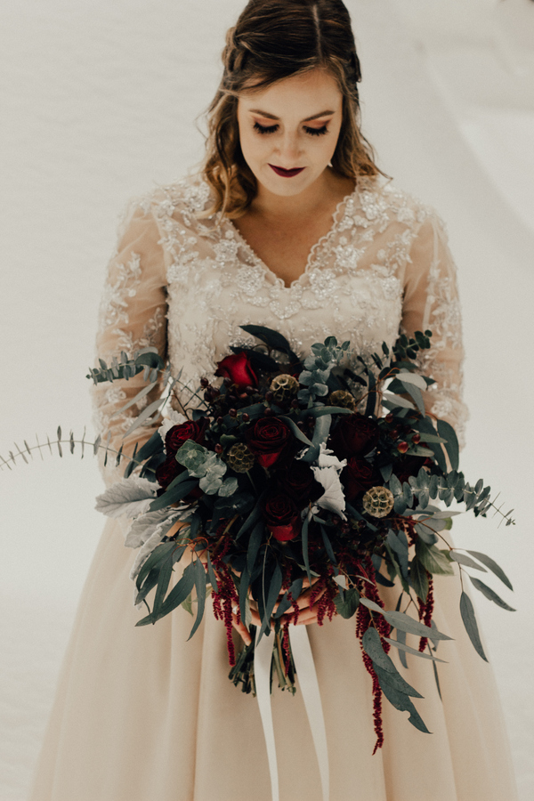 a very dark burgundy lip and subtle burgundy smokeys are a great idea for an elegant fall wedding