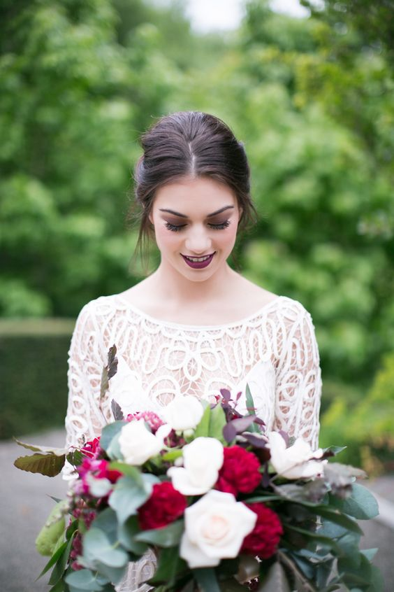 an aubergine lip is a bold and non traditional idea and is a great way to stand out a lot on your big day