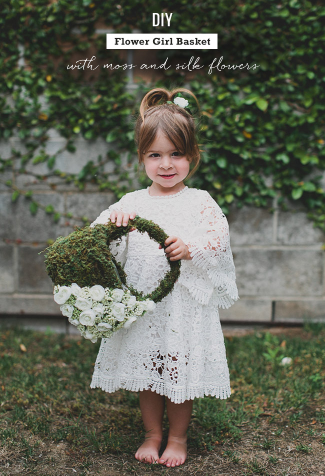 DIY moss flower girl basket with white silk flowers (via greenweddingshoes.com)
