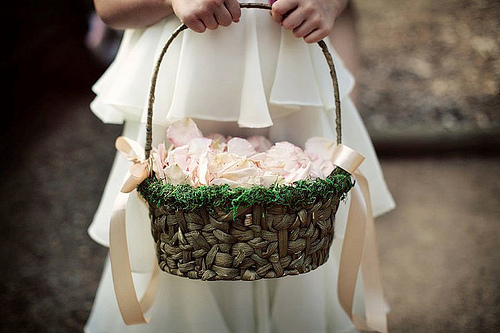 DIY flower girl basket with dried moss and ribbon bows (via www.polkadotbride.com)