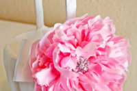DIY satin covered flower girl basket with an oversized peony