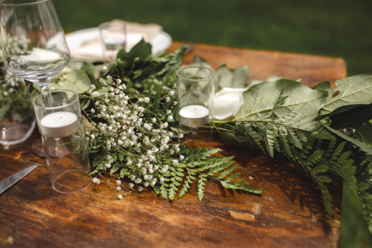 DIY fresh greenery and white bloom wedding table runner (via www.thesorrygirls.com)