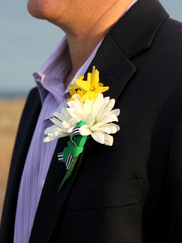 DIY groom's boutonniere of blooms and striped ribbon