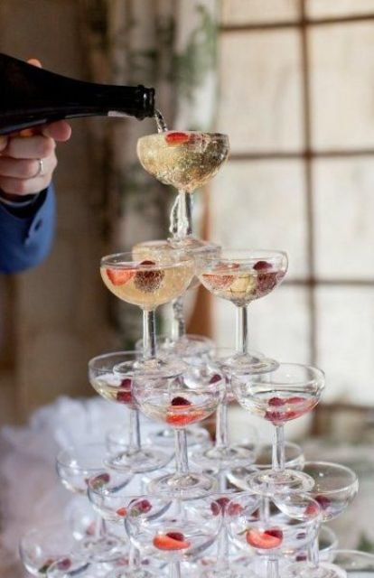 put some berries inside each glass to spurce up your champagne with a refreshing taste