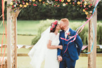 01 This cheerful summer festival wedding was filled with bright blooms and lots of fun touches