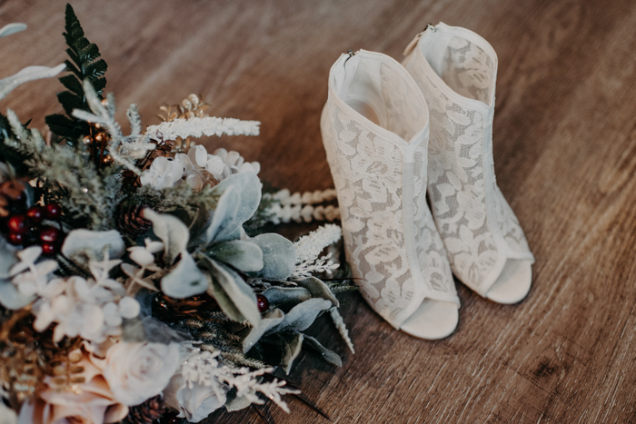 The bridal booties of white lace and with peep toes