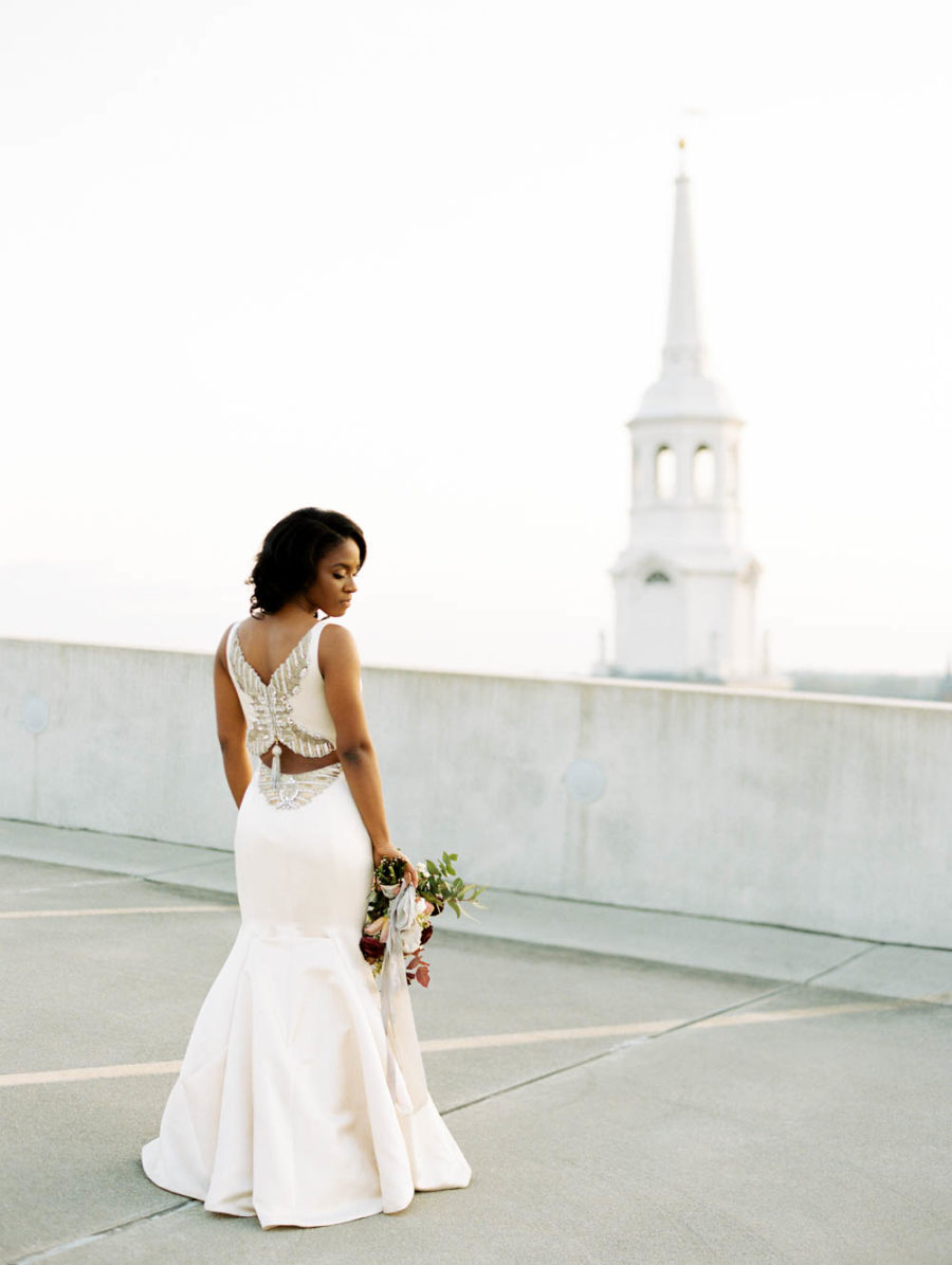 The bride was wearing a breathtaking plain fitting wedding dress with a gorgeous back
