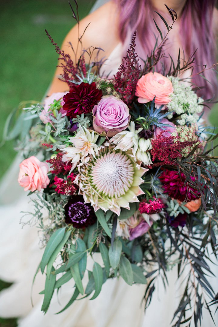 The lush wedding bouquet was done with pink, plum, fuchsia blooms and cascading greenery