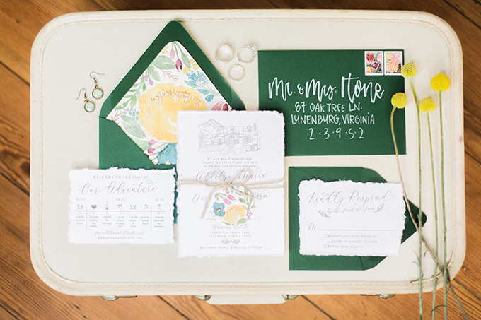 The wedding stationery was done in emerald, with a raw hem and colorful watercolor lining