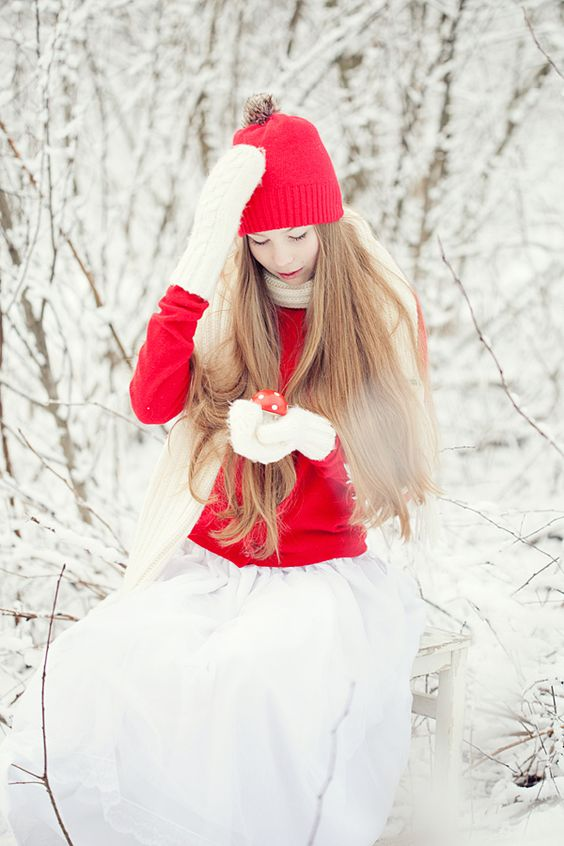 a bride rocking a red sweater and beanie plus white mittens and scarf for a bright contrast