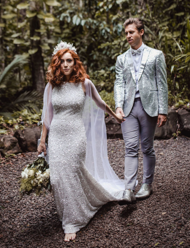 a sleeveless halter necklace silver sheath weddding dress with a small train, an ethereal cape and a crystal crown
