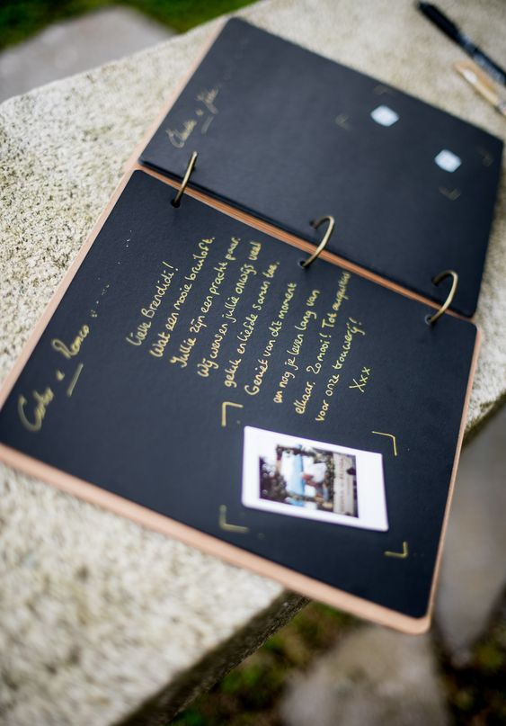 a stylish wedding guest book with Instax pics of your guests and wishes from them