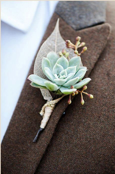 a succulent boutonniere with berries and a tiny ethereal leaf is all you need for a chic and edgy look