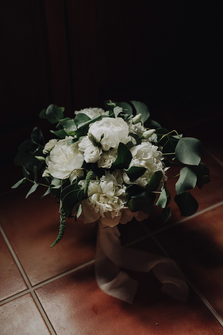 Her bouquet was all white and with lush foliage for a fresh look