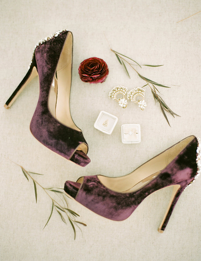 She was wearing deep purple velvet heels with embellished backs for a bright touch in her look