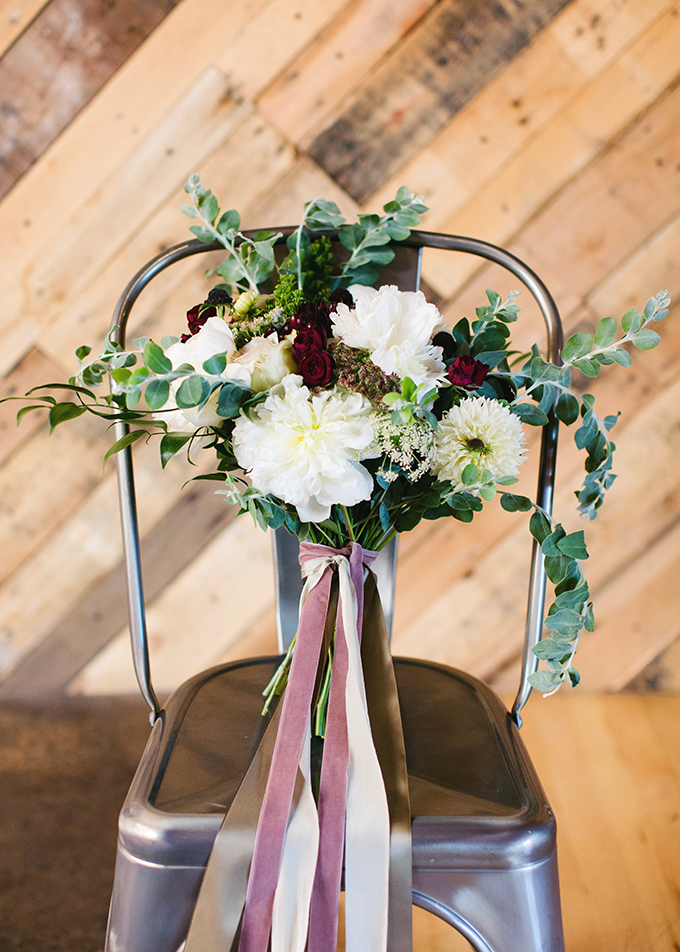 The bridal bouquet was a lush yet simple one, with burgundy and white blooms and pink and white ribbons
