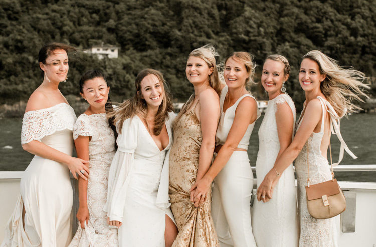 The bridal party was dressed in white for the rehearsal dinner