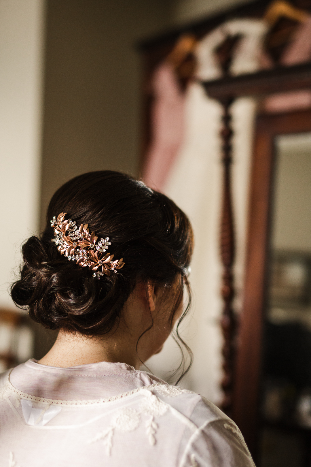 The bride was rocking an elegant wavy updo and a vintage copper hairpiece with rhinestones
