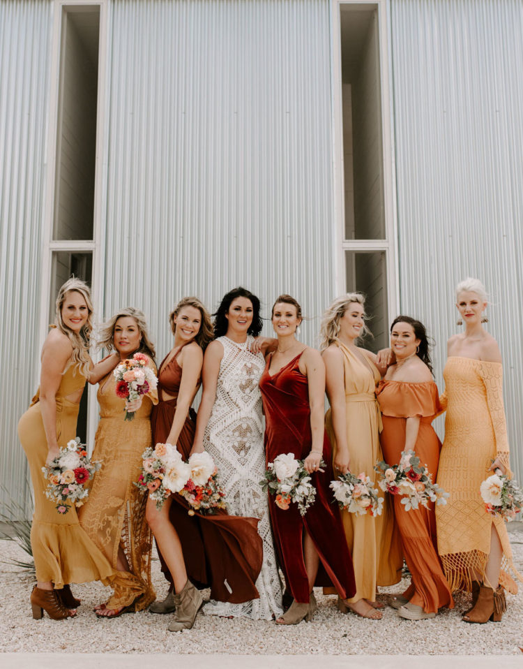 The bridesmaids were wearing a selection of mustard, rust, burgundy gowns in boho style and suede booties