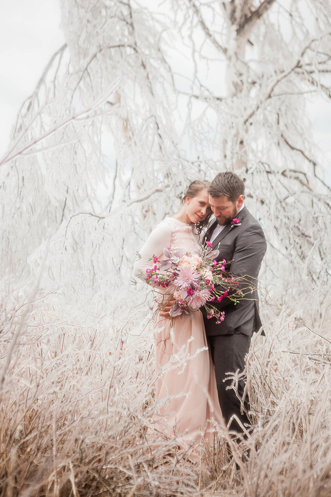 The groom was rocking a grey suit with a silver bow tie and a hot pink bloom boutonniere