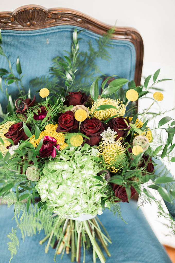 The wedding bouquet was a super lush one, with burgundy, green and mustard blooms that showed off a fall color palette