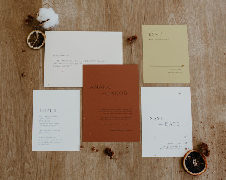 The wedding invitation suite is done in a muted color palette