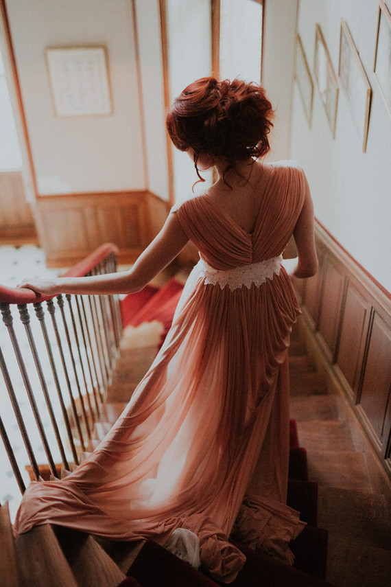 Her peachy pink back was a perfect match for her deep red hair and a romantic updo