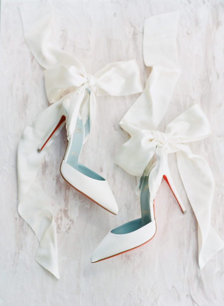 Here are chic white shoes with oversized bows that the bride wore